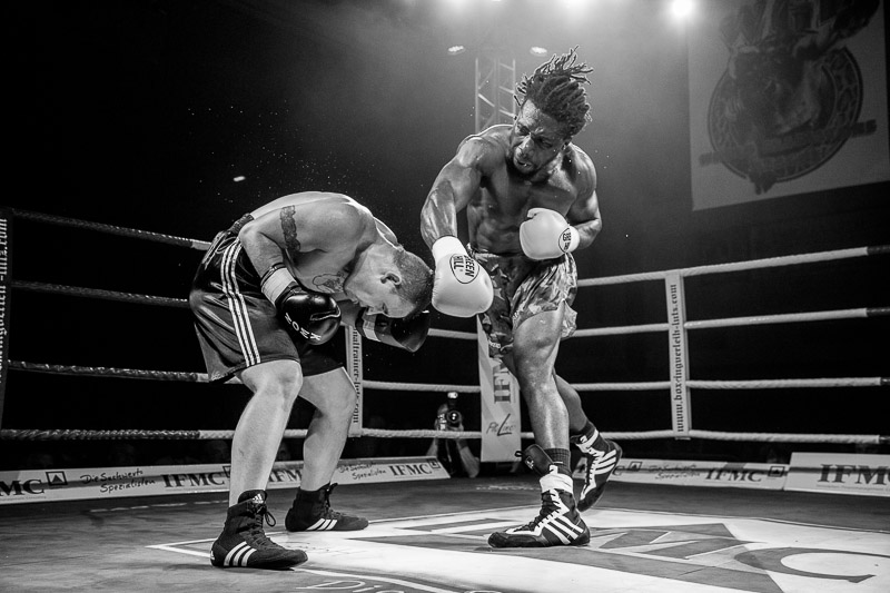 Anthony The Prince Ikeji (r) throws a punch at his opponent Istvan Bobis (l).