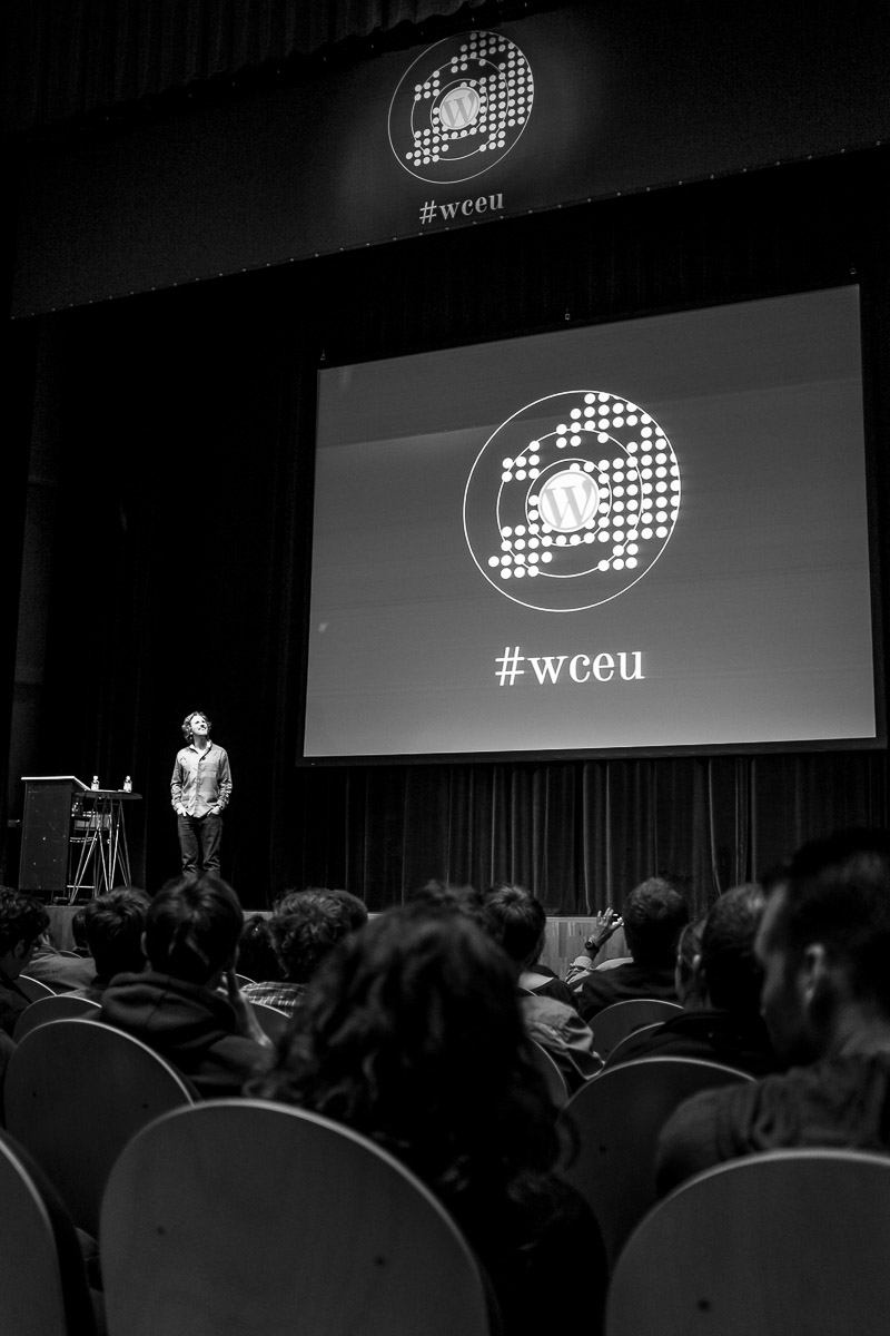 Matt Mullenweg, founding developer of WordPress, looks up to the balcony to answer a question during the Q&A session at WordCamp Europe 2013.