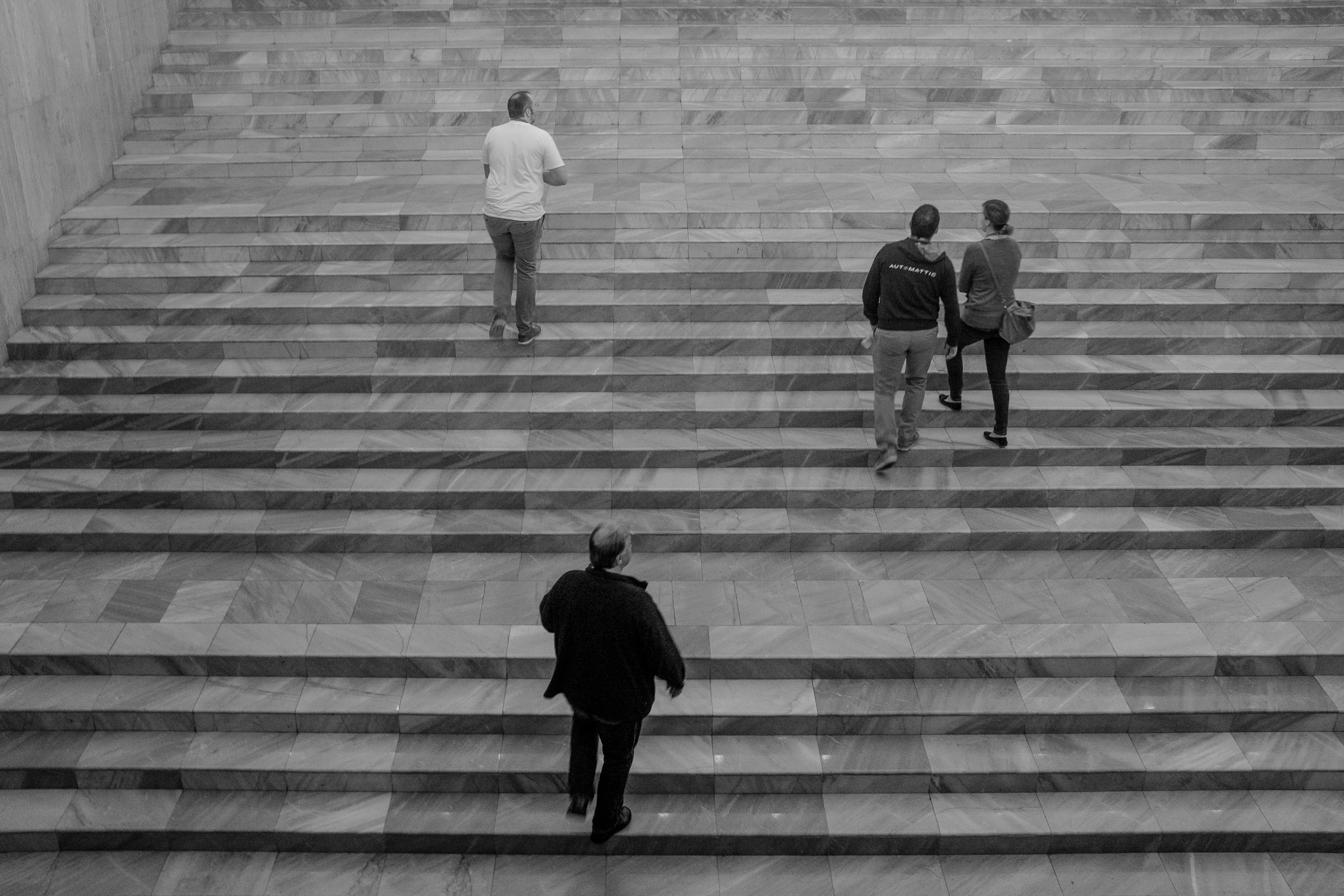 Attendees climbing the steps to the main auditorum in the National Palace of Culture in Sofia, Bulgaria.