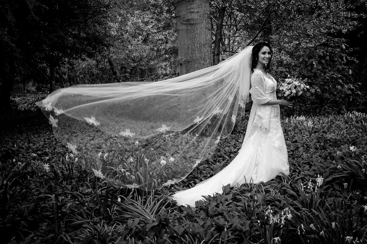 The bride, veil flowing in the wind
