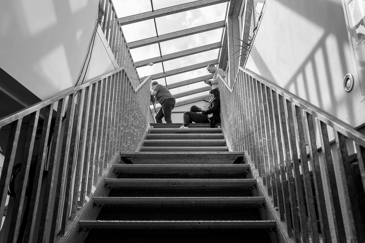Attendees relaxing on a staircase
