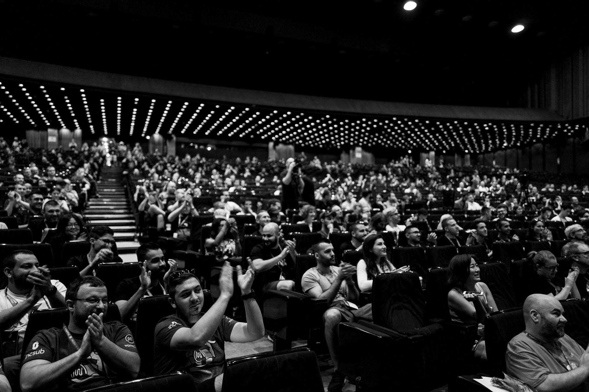 The audience in the Milkyway auditorium applauding