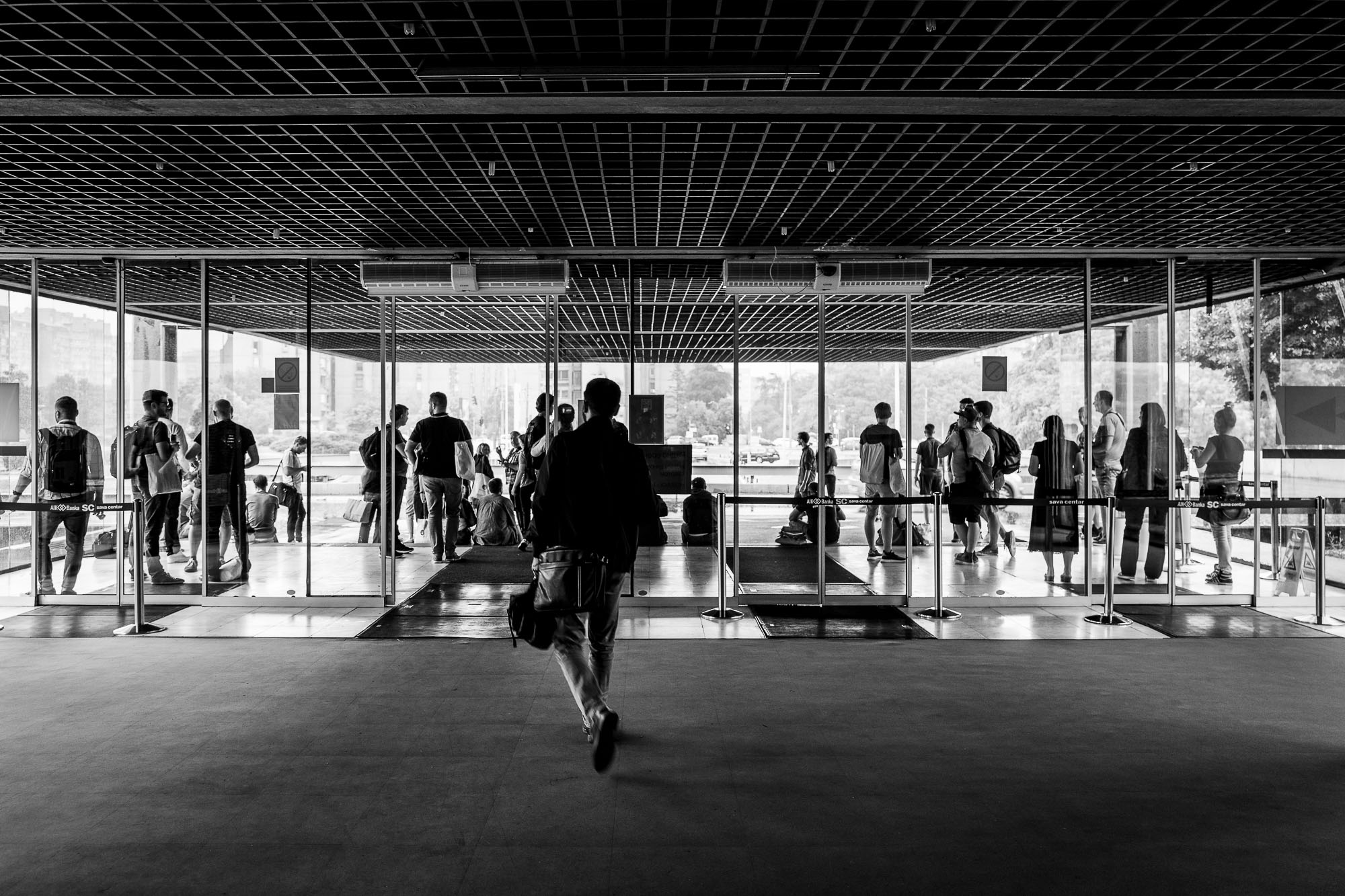 Silhouetted attendees in the entrance of Sava Center