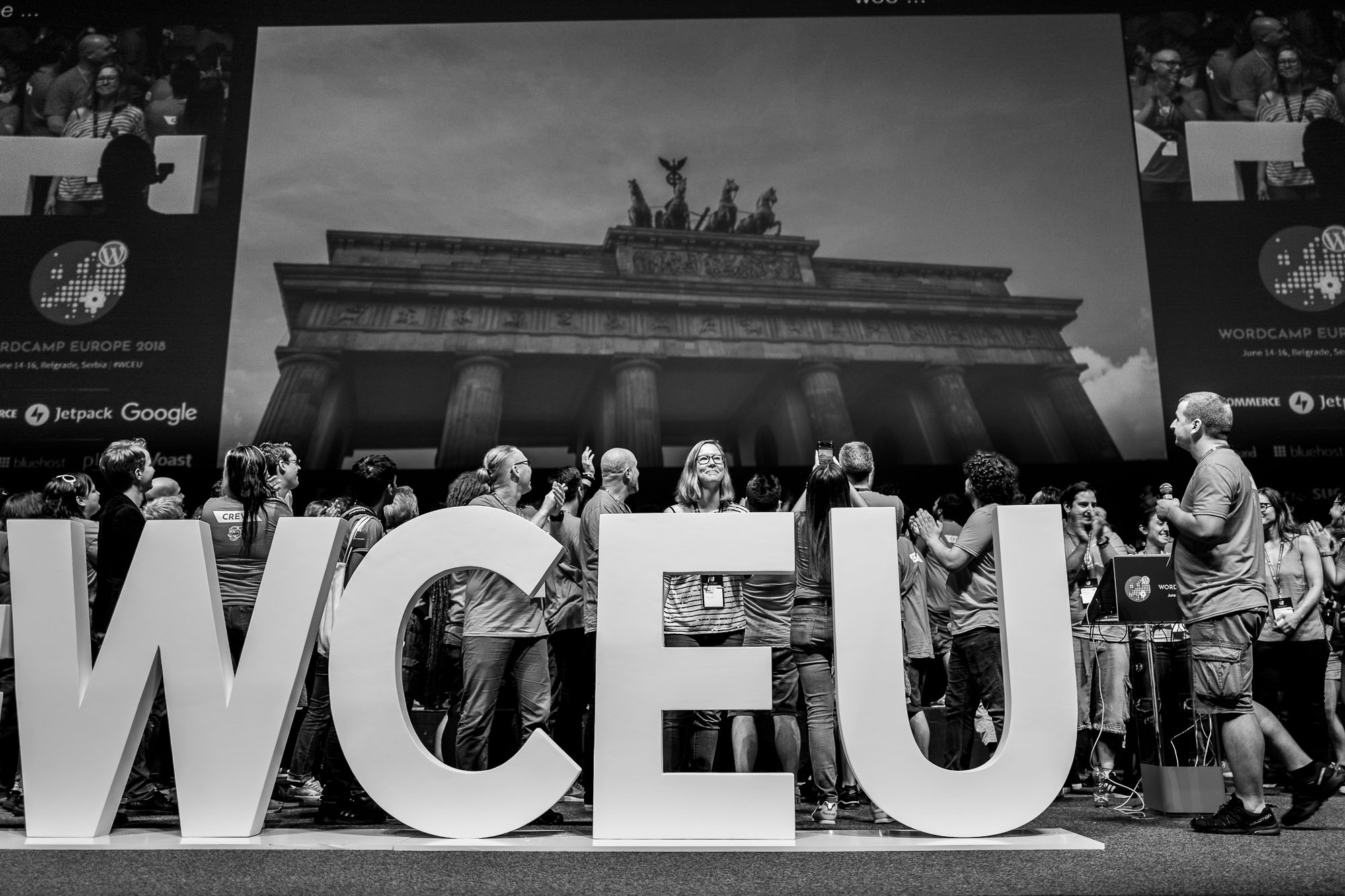 Organizers and volunteers behind the WCEU hashtag, the projected image of the Brandenburg Gate above them