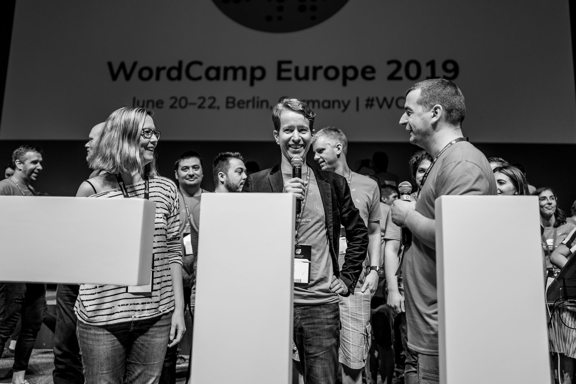 Jenny, Bernhard and Milan behind the WCEU hashtag with microphones