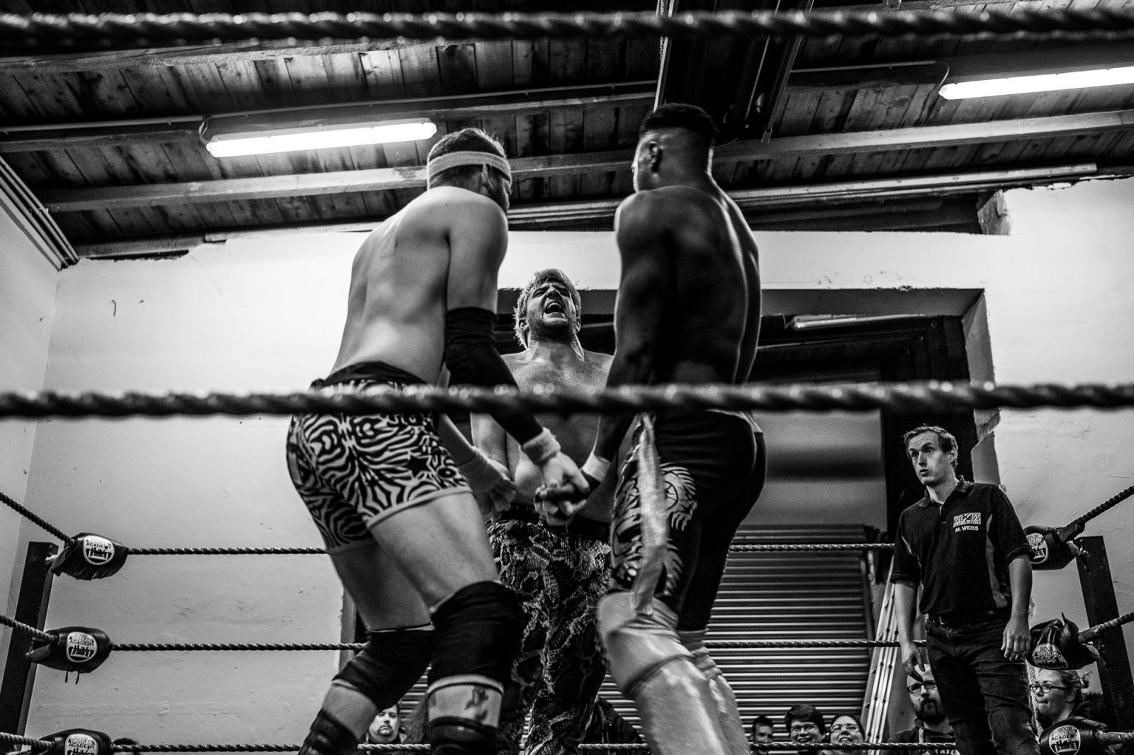 Wrestlers lock up in the ring